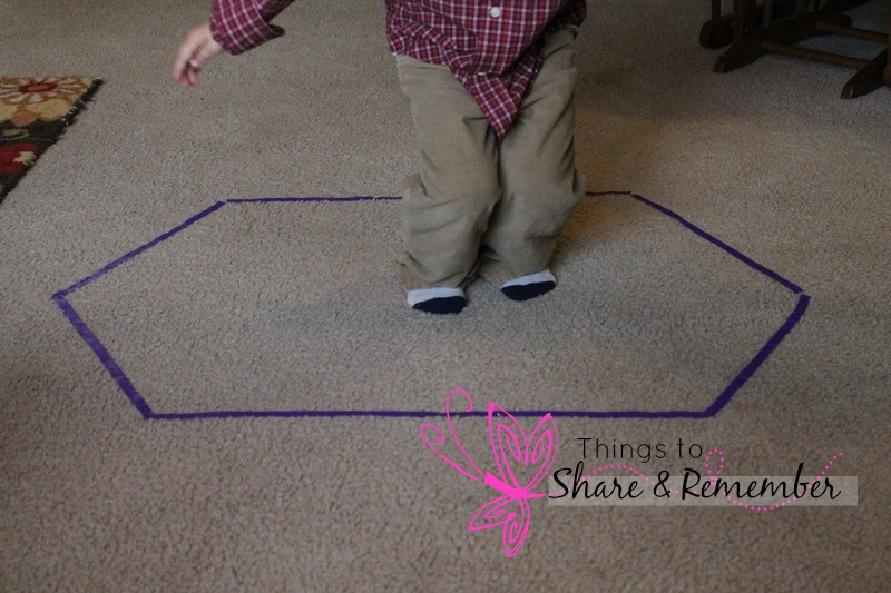 jumping into a preschool shape activity