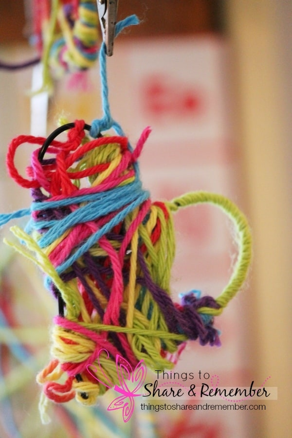 Yarn Wrapped Hearts - Valentine Craft for little hands. Wrapping yarn around a wire shape is fun for all ages!