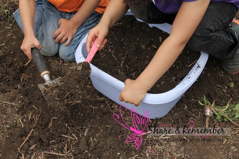 scooping soil outside