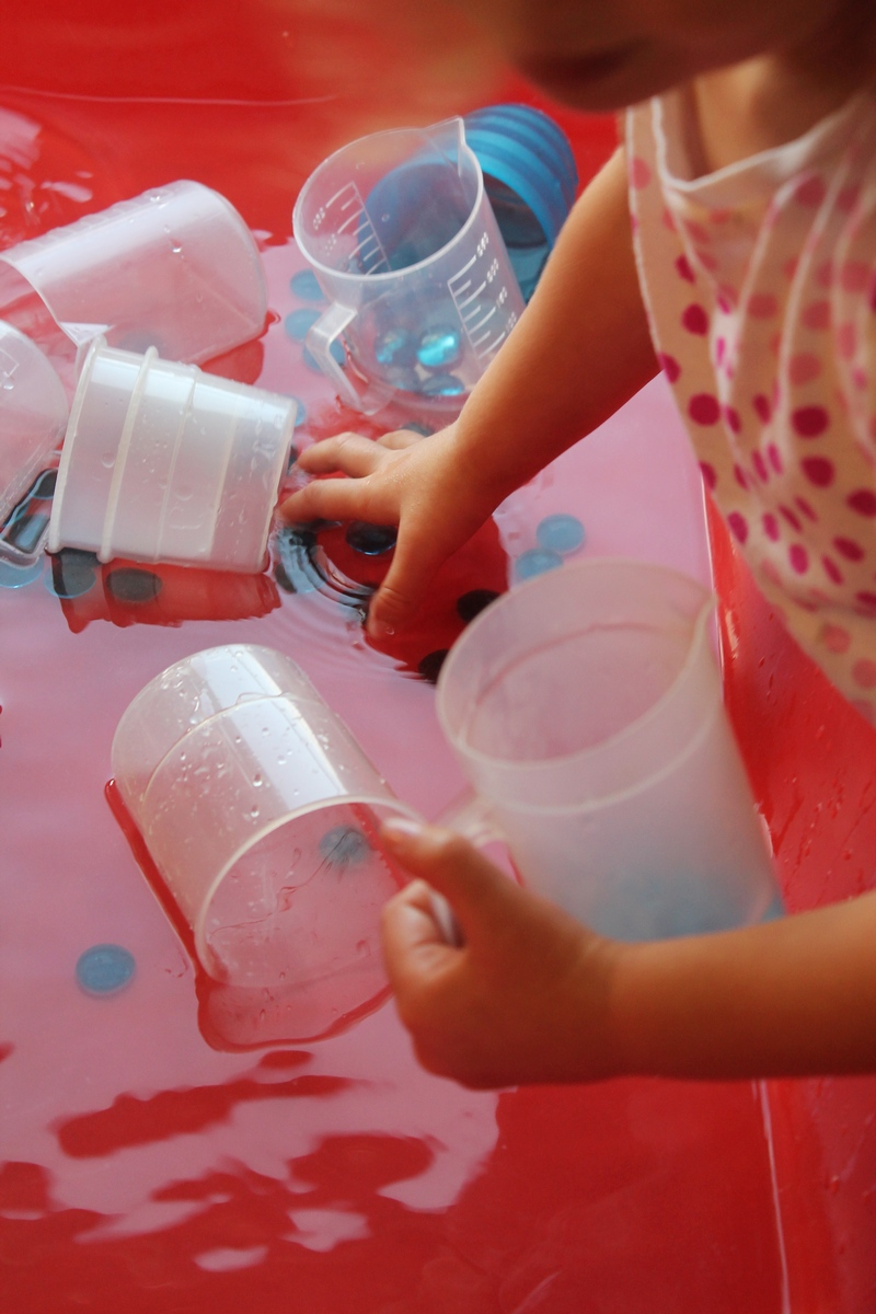 water and pebbles sensory play