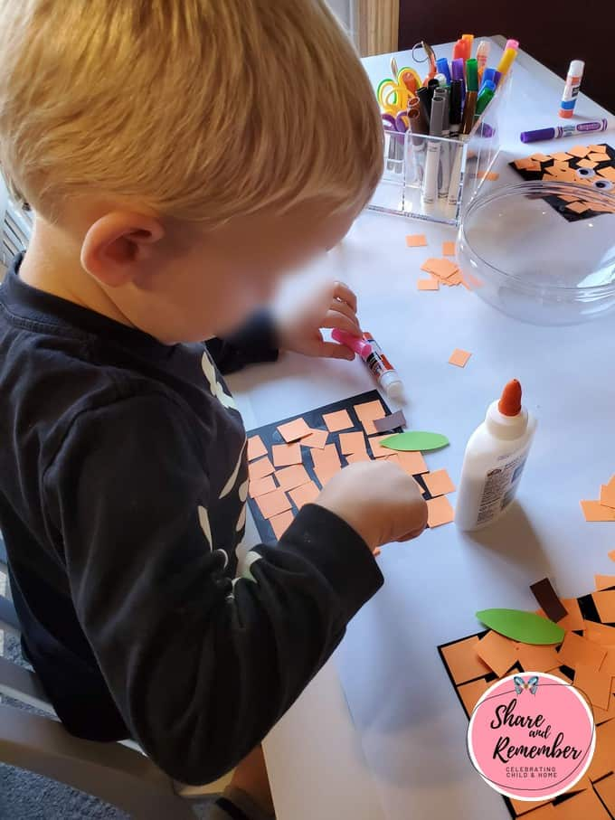 Child making a Spookley the Square Pumpkin Craft.