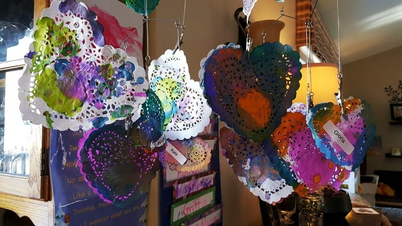 Valentine doily hearts painted with watercolors