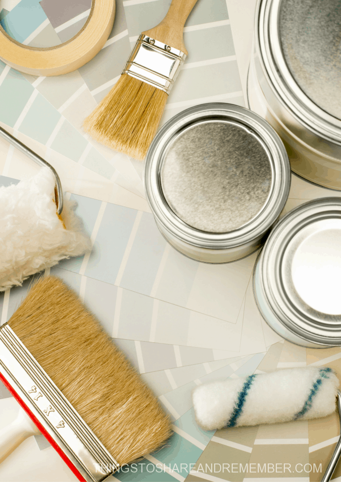 paint samples, paint cans and brushes for home updates