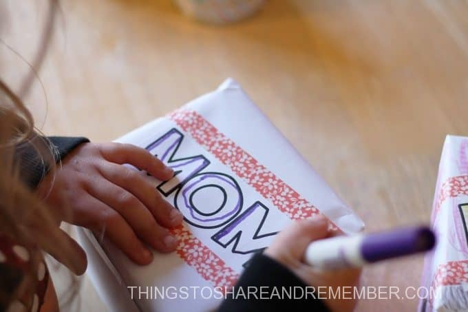 decorating gift boxes for Mother's Day in preschool
