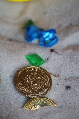 treasure sand sensory play coins