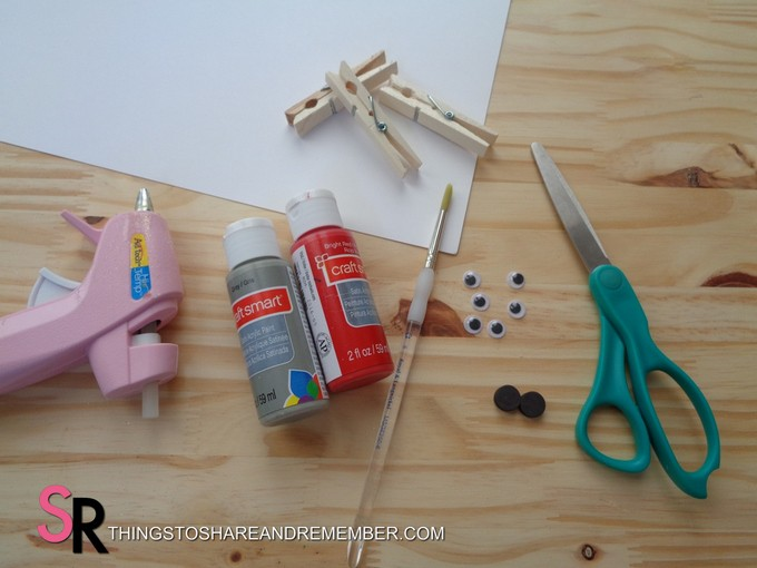 glue gun, paint, brush, clips and scissors for shark clip craft