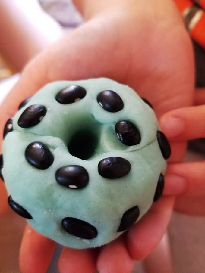 Play dough ant hills with black beans