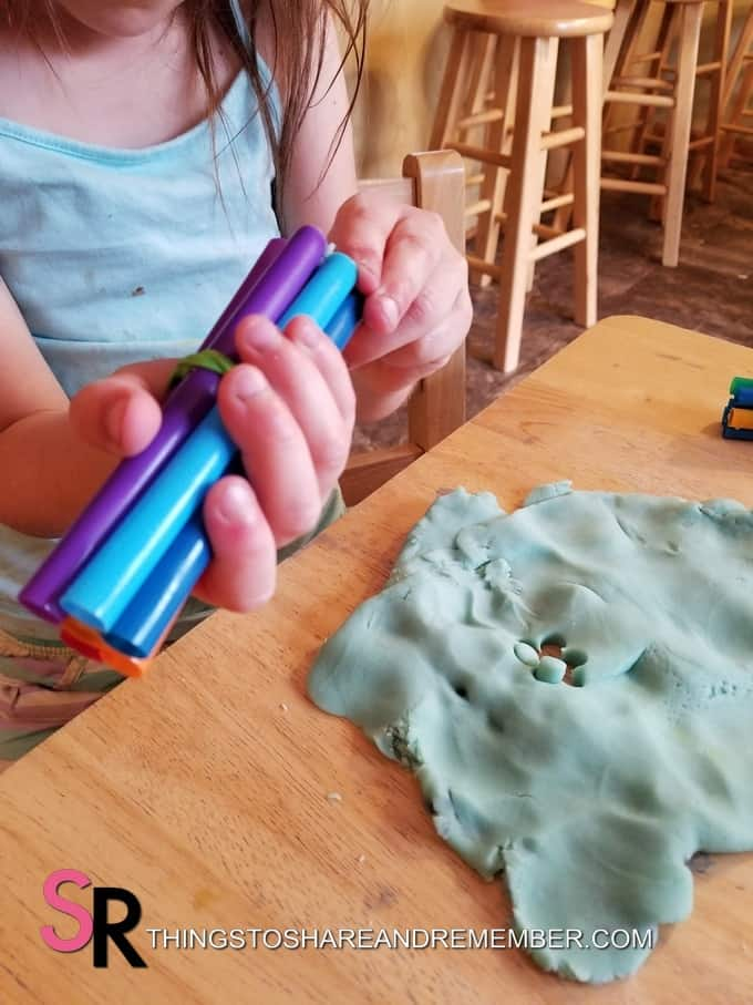 play dough and straws