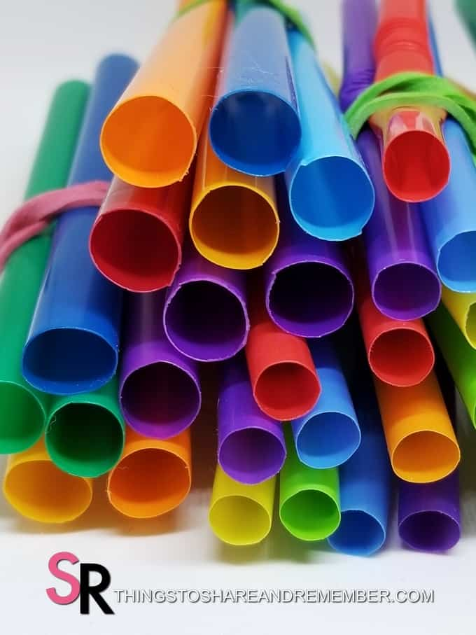 ends of colorful straws wrapped with rubber bands