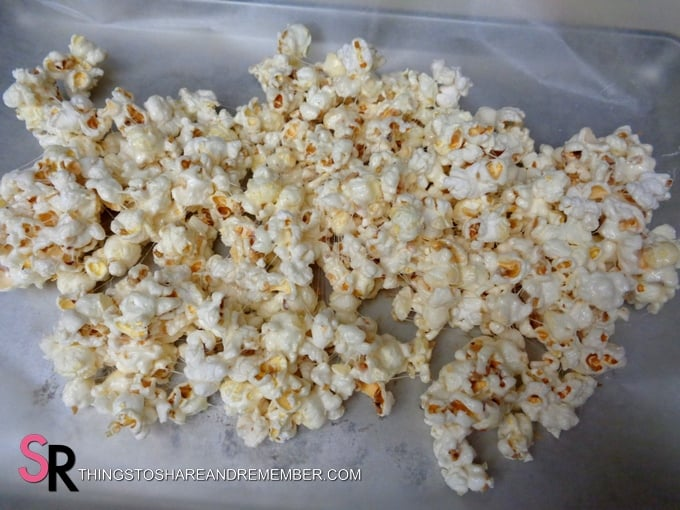 lay popcorn out on a wax paper covered cookie sheet