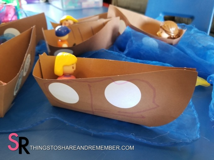 paper boats with dolls