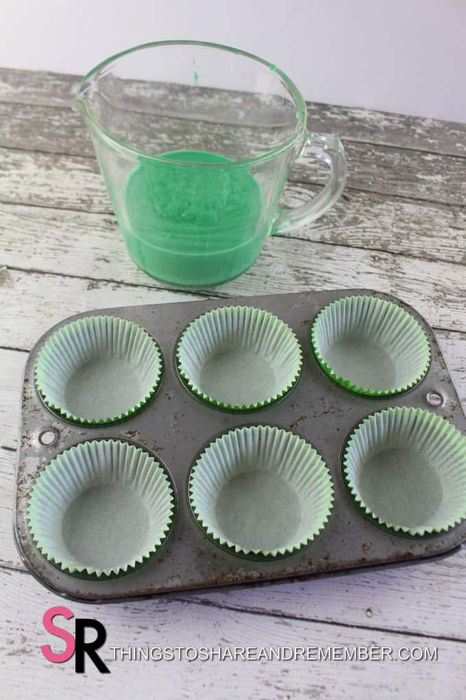 cupcake batter and cupcake liners in pan