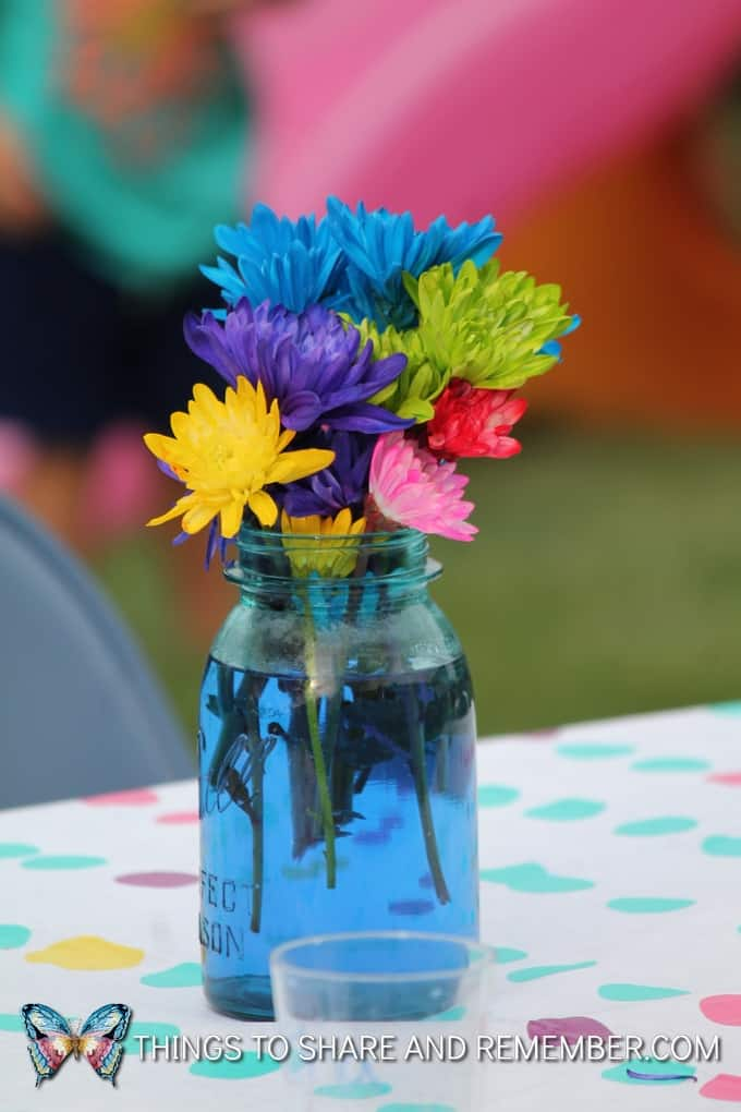 colorful flowers in vases garden party