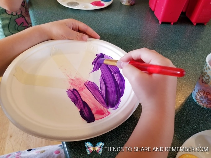 painting paper plate peace symbol