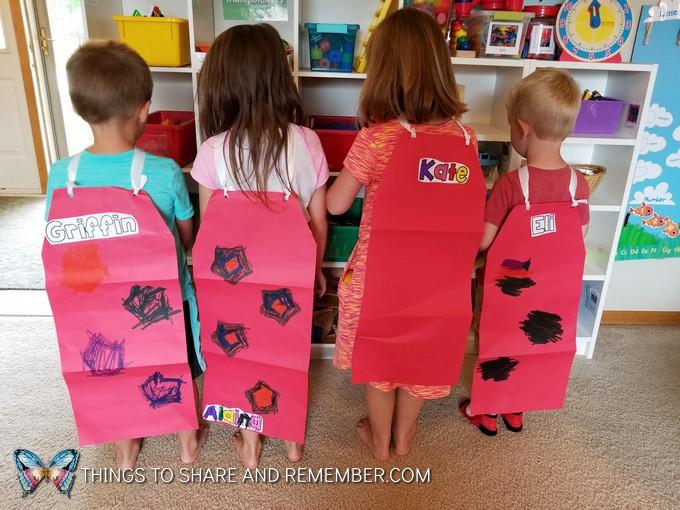 children wearing capes