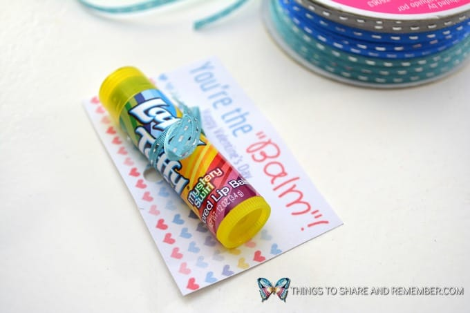 tie lip balm on valentine card with ribbon