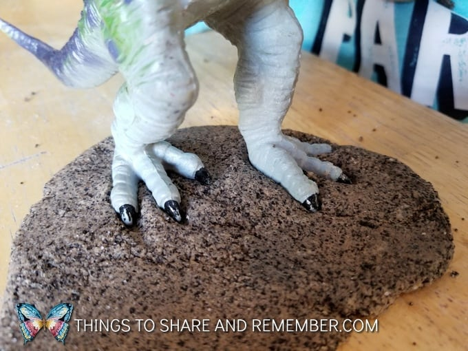 dinosaur feet in play dough