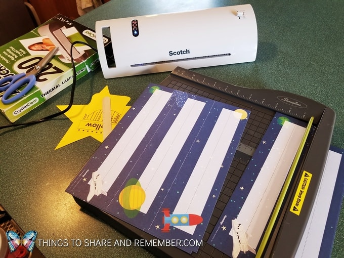 laminating and cutting preschool materials