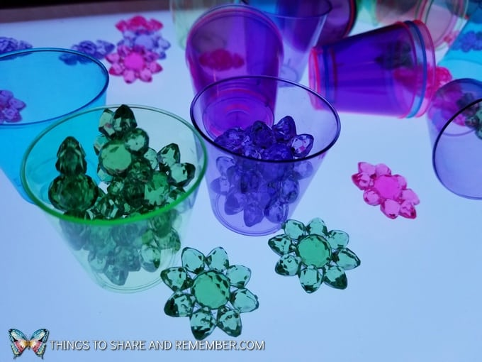 pastel flowers and cups on the light table
