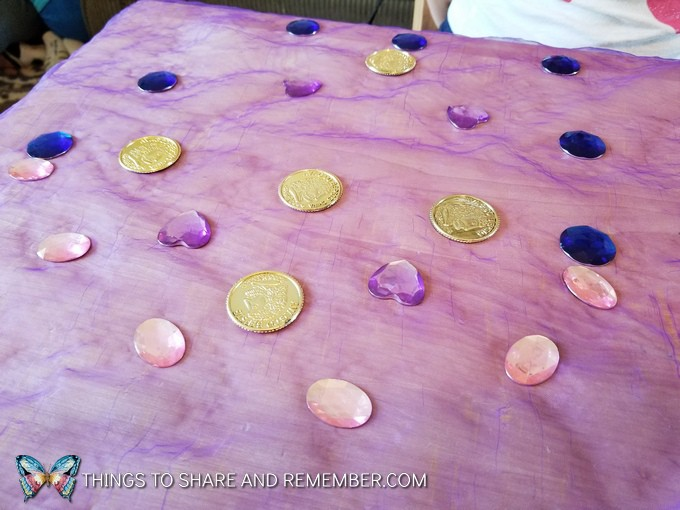 decorating scarves with gems and coins Gems and Jewels Sensory and Sorting Play Activities Preschool Activities