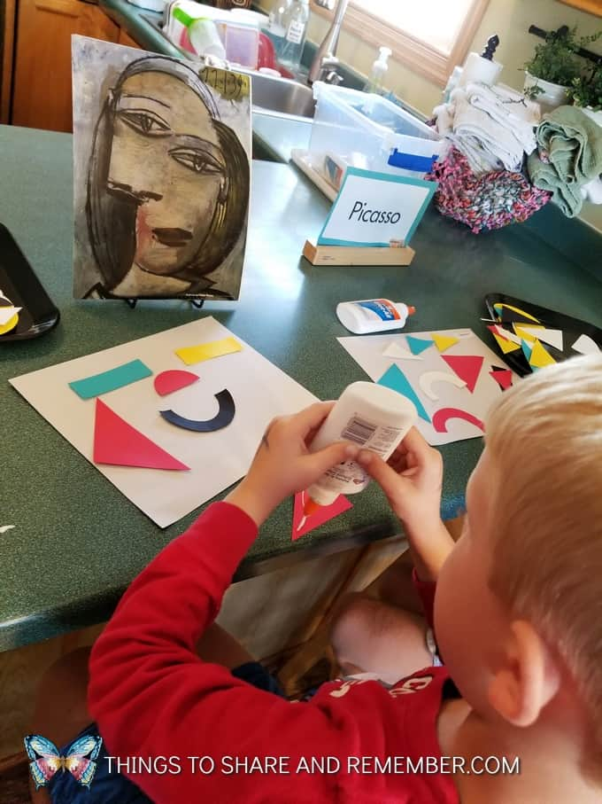 gluing shapes on paper in preschool Picasso in Preschool