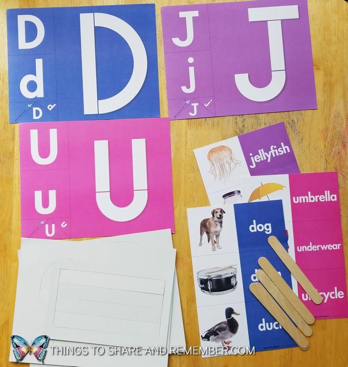 letters D, J, U loose parts letters pieces and alphabet cards