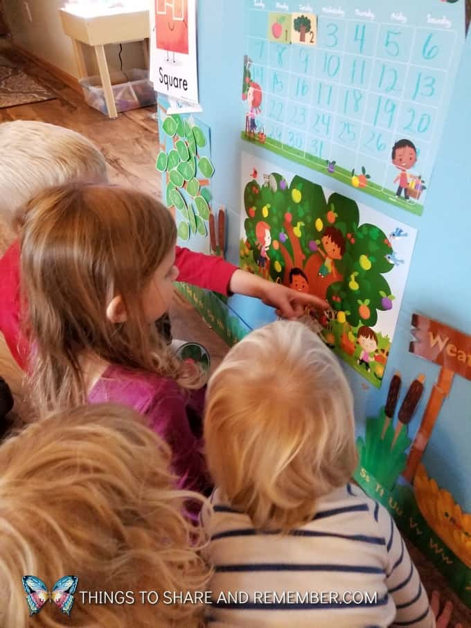 children using mother goose time theme poster during  super fun circle time