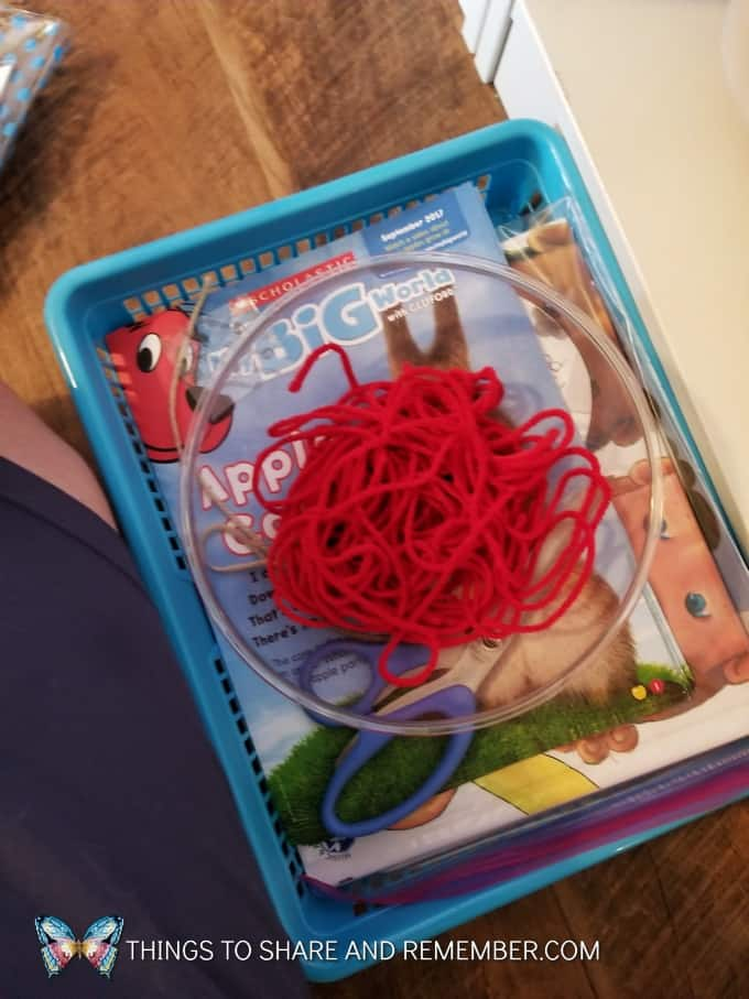 bowl with red yarn basket with Scholastic My Big World Clifford Magazines for  super fun circle time