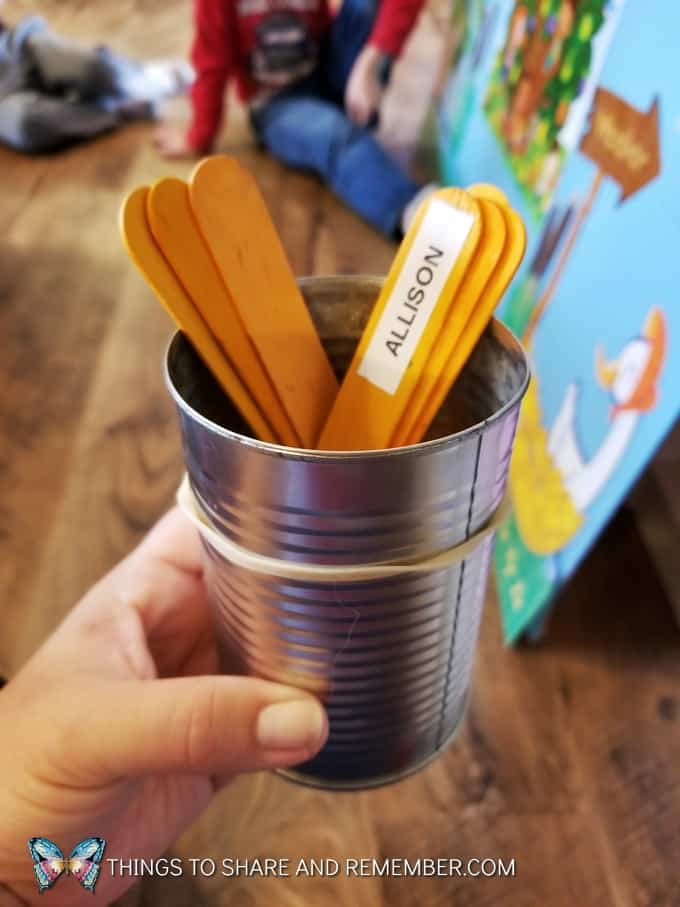 tin can with craft sticks with names on them for taking turns  super fun circle time