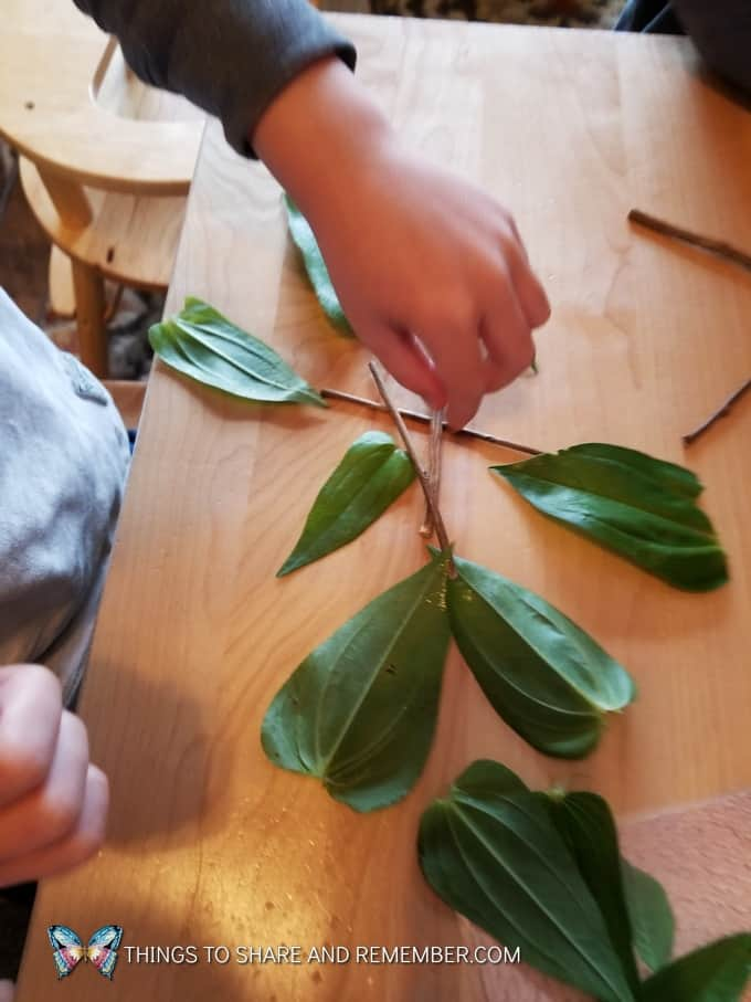 making a design with leaves and sticks Loose Parts Nature Designs