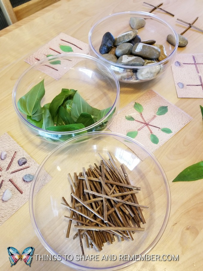 bowls with leaves, rocks and sticks for making Loose Parts Nature Designs in preschool