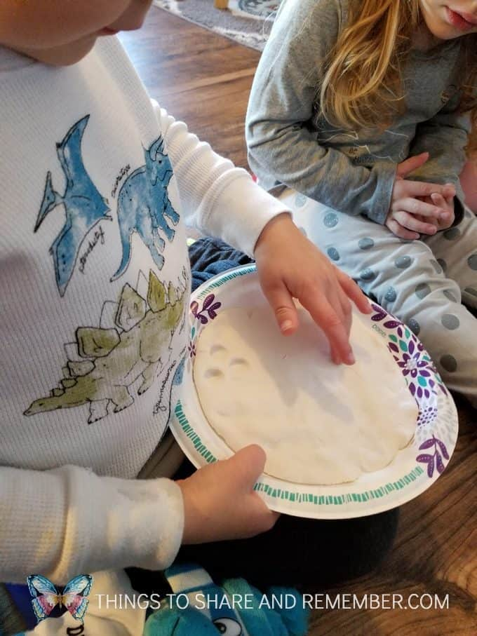 Making fingerprints in play dough or animal tracks in the snow #MGTblogger #MotherGooseTime #preschool #SightsandSounds #preschoolcurriculum