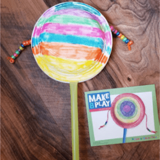 Pellet drum paper plate instrument preschool craft - Mother Goose Time Sights and Sounds theme
