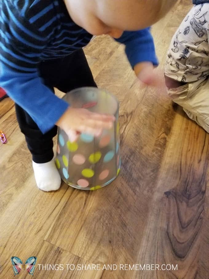 Basket drum for toddler play and exploration of drums. What can you pound on or tap to make noise? #MGTblogger #MotherGooseTime #SightsandSounds