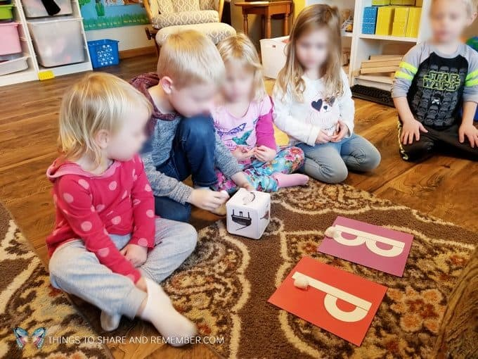 Playing flying owls game identifying letters B & P