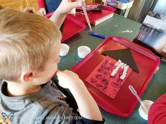 Dripping icicles art activity for winter ice lessons. Painting with thinned paint and pipettes to make icicles. #MGTblogger #MotherGooseTime #SightsandSounds