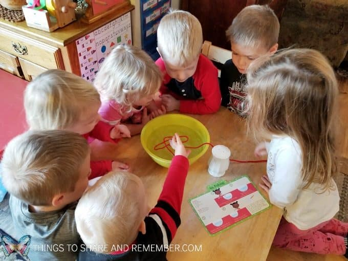 Preschool winter ice activities: ice fishing science experiment for preschoolers involving ice freezing and melting #SightsandSounds #MotherGooseTime #MGTblogger