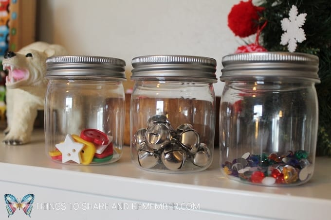 Small plastic jars with a variety of contents to experiment with shaking and hearing the sound. Can you shake it loud? Can you shake it quietly? #STEAM #preschoolSTEAM #STEAMStation #preschool #sensory #SightsandSounds #MGTblogger #MotherGooseTime
