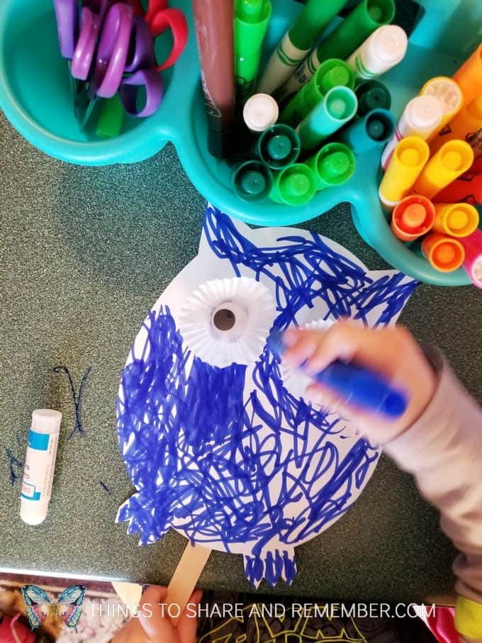 Coloring an owl puppet Make and Play craft activity for preschoolers #MakeandPlay #MotherGooseTime #preschool #familychildcare #MGTblogger