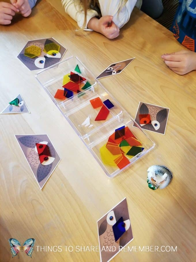 Owl shapes game from Mother Goose Time preschool curriculum. Match the transparent pattern block shapes to the owl. #MGTblogger #MotherGooseTime