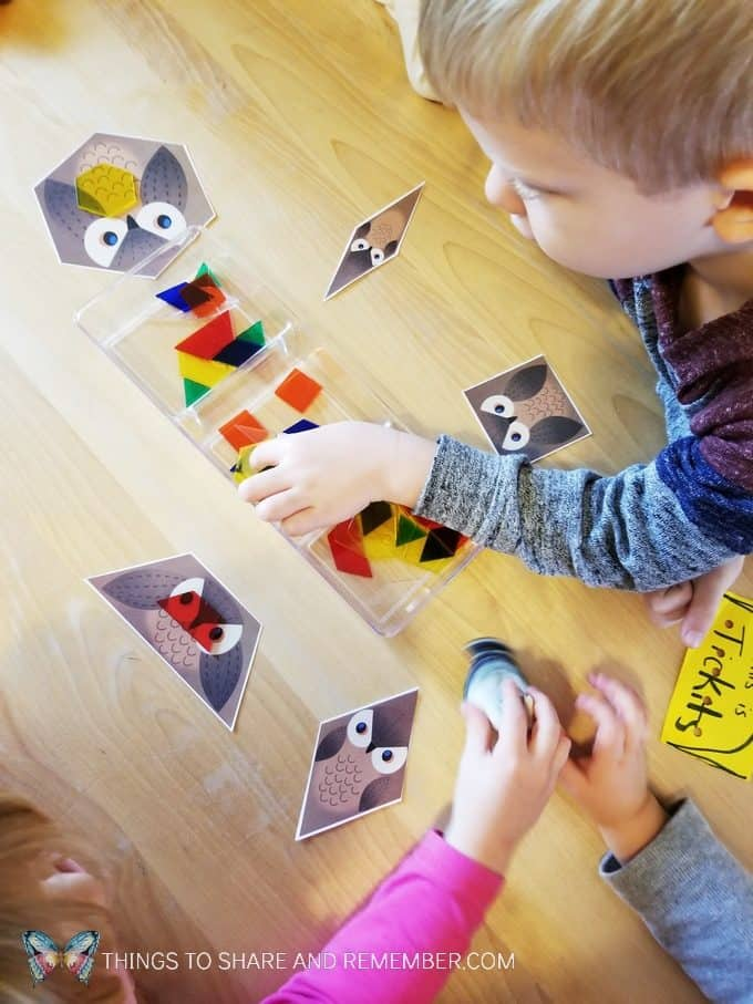 Owl shapes game from Mother Goose Time preschool curriculum. Match the transparent pattern block shapes to the owl.