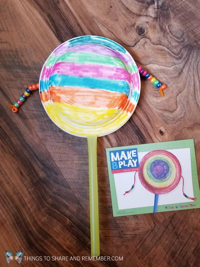 Pellet Drum Make and Play instrument made from paper plates, straw, yarn and beads. #SightsandSounds #MakeandPlay #MotherGooseTime #preschoolactivities #musicforkids #MGTblogger