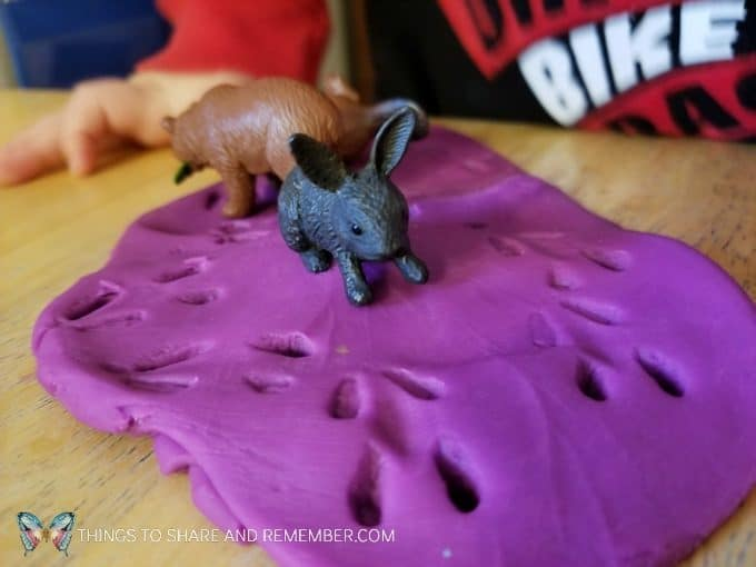 Animal tracks in the snow play dough sensory play with animals and play dough #MGTblogger #MotherGooseTime #preschool #sensory #playdough #SightsandSounds