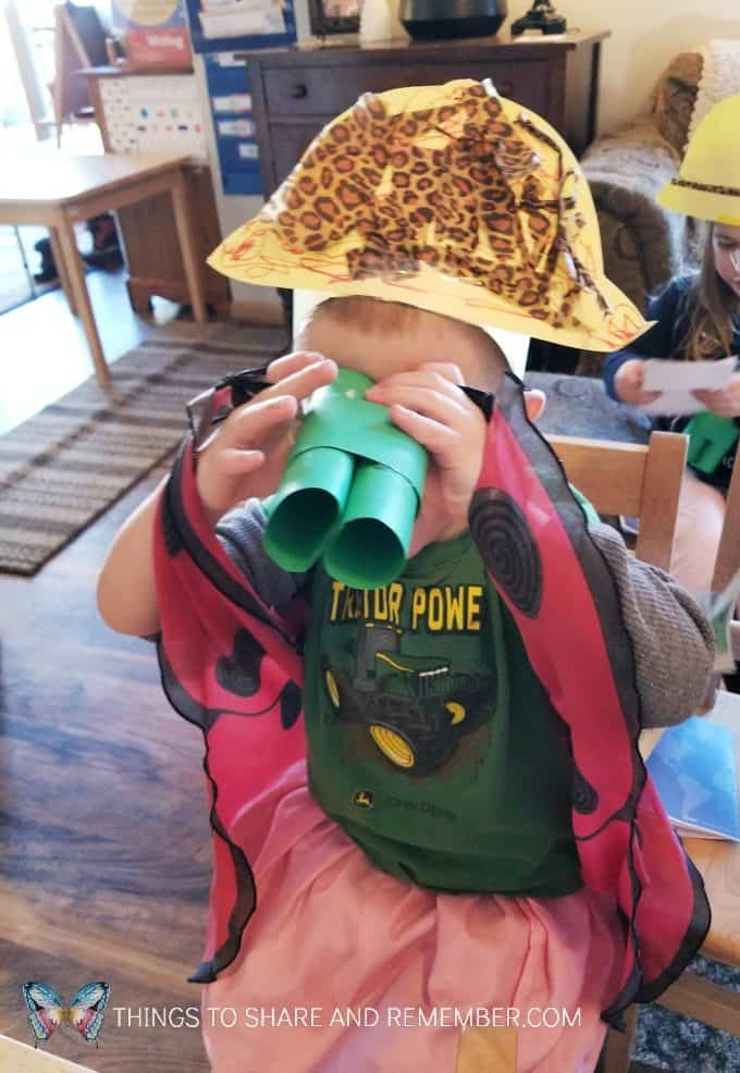 child using binoculars and wearing a safari hat craft Going on Safari preschool theme binoculars craft and related activities for preschoolers #MGTBlogger #MotherGooseTime #preschool #preschoolcurriculum #GoingOnSafari #safaritheme