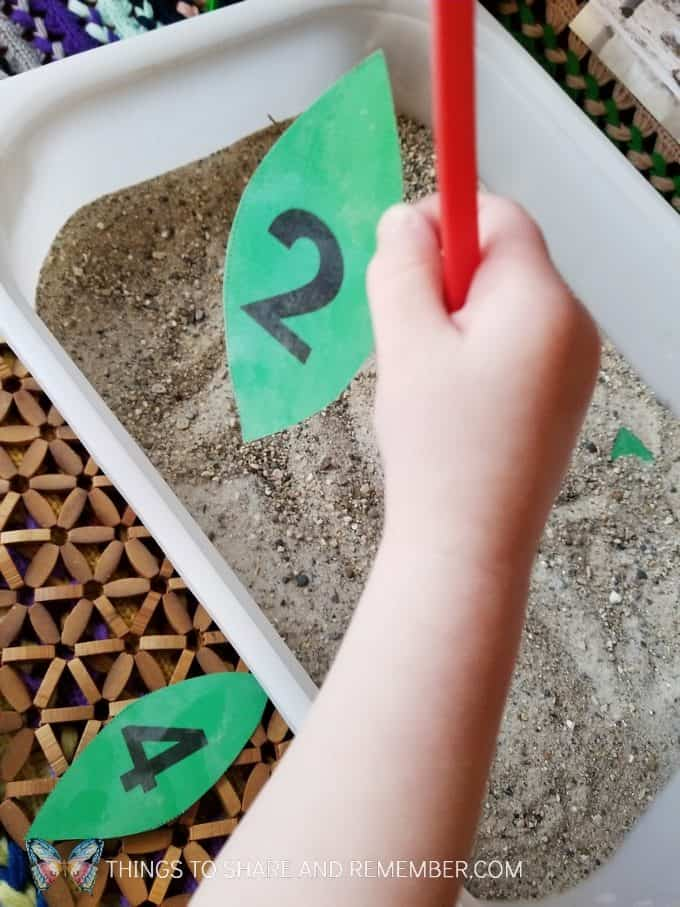 elephant tusks digging for number leaves sensory and math activity for preschoolers from Mother Goose Time #MGTBlogger #MotherGooseTime #GoingOnSafari #preschool #ece