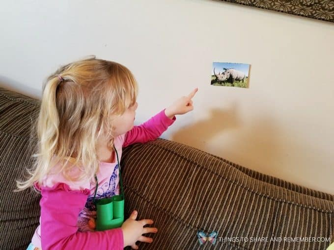 child looking at a rhinoceros Going on Safari preschool theme binoculars craft and related activities for preschoolers #MGTBlogger #MotherGooseTime #preschool #preschoolcurriculum #GoingOnSafari #safaritheme