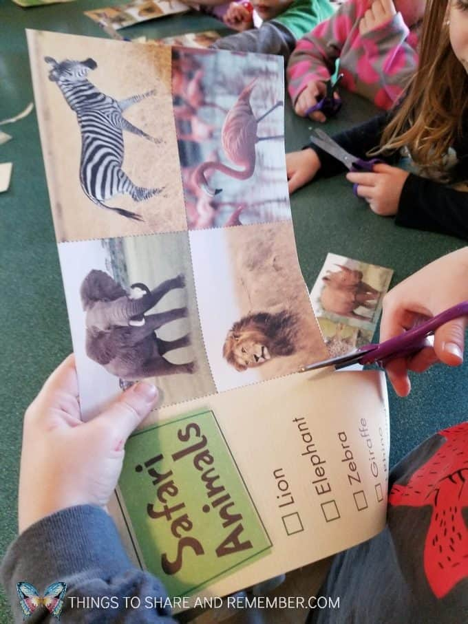 scissor practice for preschoolers with Mother Goose Time Going on Safari preschool theme binoculars craft and related activities for preschoolers #MGTBlogger #MotherGooseTime #preschool #preschoolcurriculum #GoingOnSafari #safaritheme