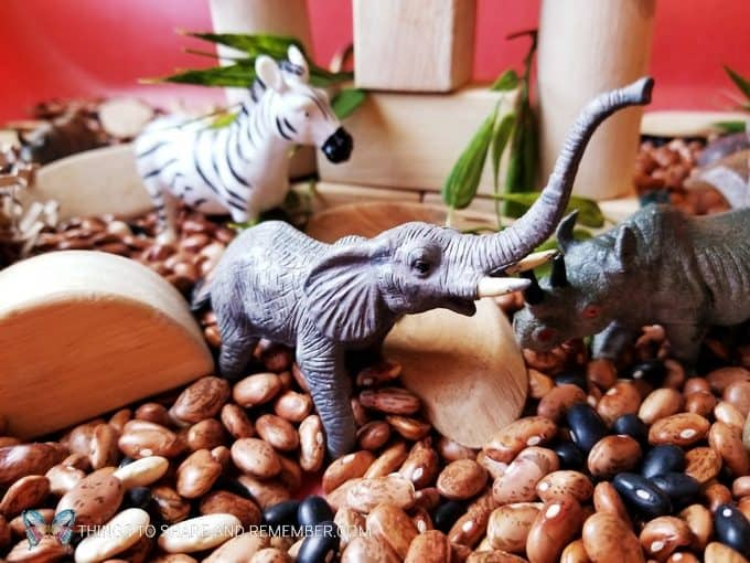 Elephant and a zebra safari animals Safari Habitat Sensory bin with animals for preschoolers Going on Safari theme from Mother Goose Time preschool curriculum #MGTblogger #MotherGooseTime #preschool #GoingonSafari #sensorybin #sensoryplay #smallworld #invitationtoplay