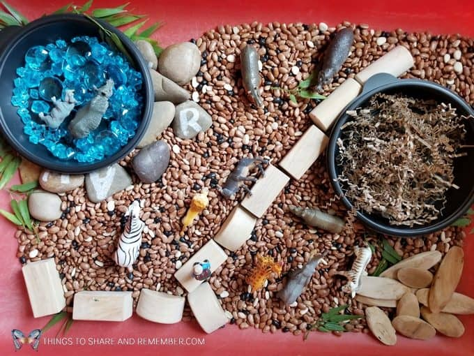 Safari Habitat Sensory bin with animals for preschoolers Going on Safari theme from Mother Goose Time preschool curriculum #MGTblogger #MotherGooseTime #preschool #GoingonSafari #sensorybin #sensoryplay #smallworld #invitationtoplay