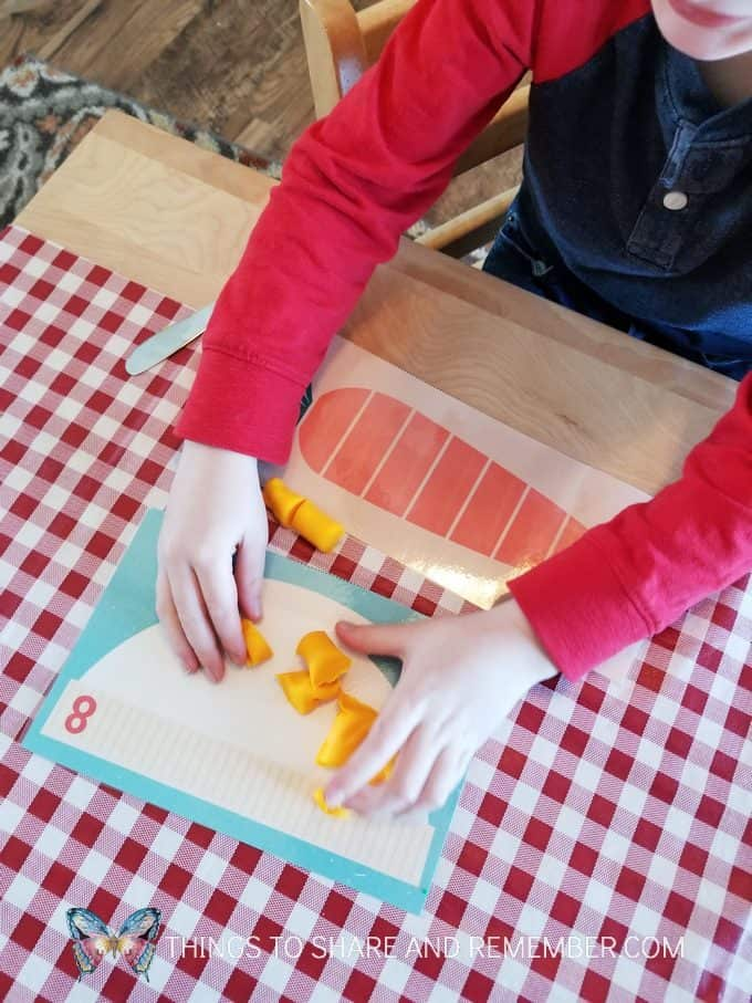 counting carrots into a bowl Slice and Count Play Dough Math Activity